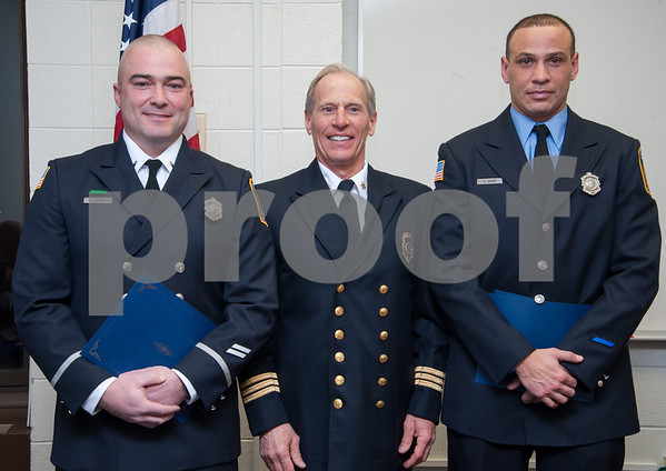 01/22/18 Wesley Bunnell | Staff The Bristol Fire Department honored two of their own on Monday evening for helping save the life of an elderly woman. Lt. Lance Lavore, L, and FF Adam Hayes, R, stand with Deputy Chief John Ziogas after Ziogas read their citations during the fire commission meeting at city hall.