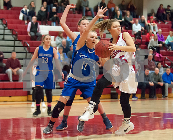 01/22/18 Wesley Bunnell | Staff Southington vs Berlin girls basketball at Berlin High School on Monday evening. Southington's Kristen Longley (11) and Berlin's Carly Grega (15).