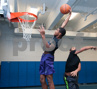 01/22/18  Wesley Bunnell | Staff  Jayden Santana goes up for the dunk during a game of basketball against other members of the high school program of the New Britain Boys and Girls Club on Monday evening.
