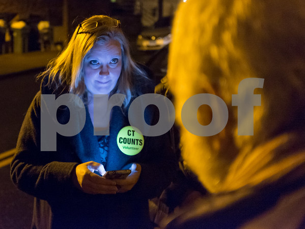01/23/18 Wesley Bunnell | Staff Volunteers from Connecticut Counts stopped by different parts of New Britain on Tuesday night as part of a larger nationwide effort to take an accurate count of sheltered and unsheltered homeless. Volunteer Signe Lambertsen as she conducts an interview and enters the information onto her phone into a mobile app.