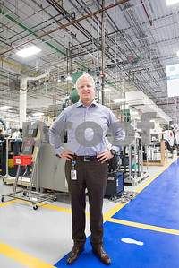 01/19/18  Wesley Bunnell | Staff  President of Okay Industries, Jason Howey, stands on the production floor of the Berlin location.