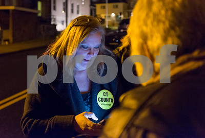 01/23/18  Wesley Bunnell | Staff  Volunteers from Connecticut Counts stopped by different parts of New Britain on Tuesday night as part of a larger nationwide effort to take an accurate count of sheltered and unsheltered homeless. Volunteer Signe Lambertsen looks down at her phone as she intakes information for the count.