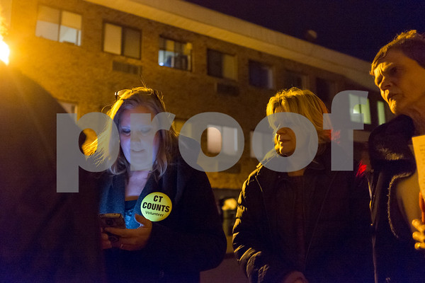 01/23/18 Wesley Bunnell | Staff Volunteers from Connecticut Counts stopped by different parts of New Britain on Tuesday night as part of a larger nationwide effort to take an accurate count of sheltered and unsheltered homeless. Volunteer Signe Lambertsen, L, Marianne Farr from the Friendship Center and volunteer Holly Ericksen stand outside of a building on Court St. as an interview is being conducted.