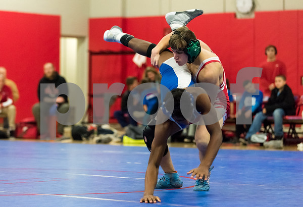 01/24/18 Wesley Bunnell   Staff Berlin wrestling defeated Plainville 54-21 at Berlin High School on Wednesday night. Berlin's Moses Marino vs Plainville's Alex Hernandez in the 152lb weight class.