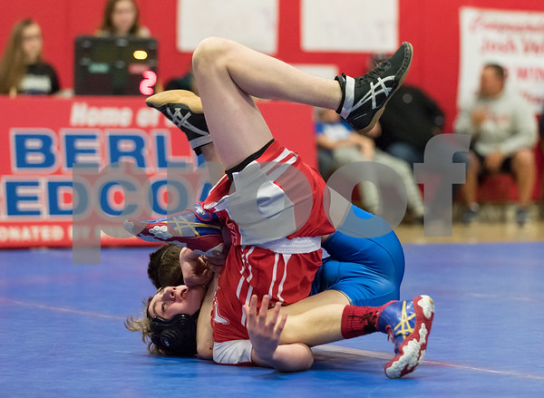 01/24/18 Wesley Bunnell   Staff Berlin wrestling defeated Plainville 54-21 at Berlin High School on Wednesday night. Plainville's Sebby Soli vs Berlin's Tyler Barber in the 126lb weight class.