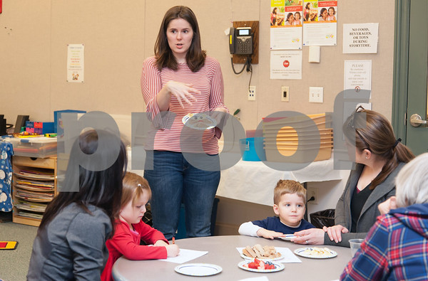 01/24/18 Wesley Bunnell   Staff Registered Dietitian Katie Shepherd brought her Food Explorers program to the Bristol Public Library on Wednesday morning to work with a group of pre school age children. The program teaches healthy food choices through sensory experiences and activities followed with hands on food exploration. Shepherd holds up a sample plate of food for the children.