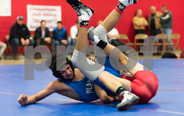 01/24/18 Wesley Bunnell   Staff Berlin wrestling defeated Plainville 54-21 at Berlin High School on Wednesday night. Plainville's Kyle Voisine vs Josh Wood in the 145lb weight class.