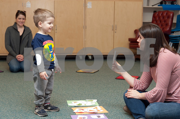 01/24/18 Wesley Bunnell   Staff Registered Dietitian Katie Shepherd brought her Food Explorers program to the Bristol Public Library on Wednesday morning to work with a group of pre school age children. The program teaches healthy food choices through sensory experiences and activities followed with hands on food exploration. Shepherd, R, helps Zachary D'Innocenzo place the foods in the correct group as mom Kate D'Innocenzo looks on.