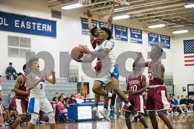 01/25/18  Wesley Bunnell | Staff  Bristol Eastern boys basketball defeated Bulkeley 58-54 in OT after trailing for most of the game. Camryn Tate (22).