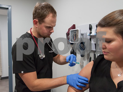 01/25/18  Wesley Bunnell | Staff  Physicians Assistant Brandon Batory from AFC Urgent Care in New Britain prepares to administer a flu shot to Medical Assistant Mikayla Perlotto.
