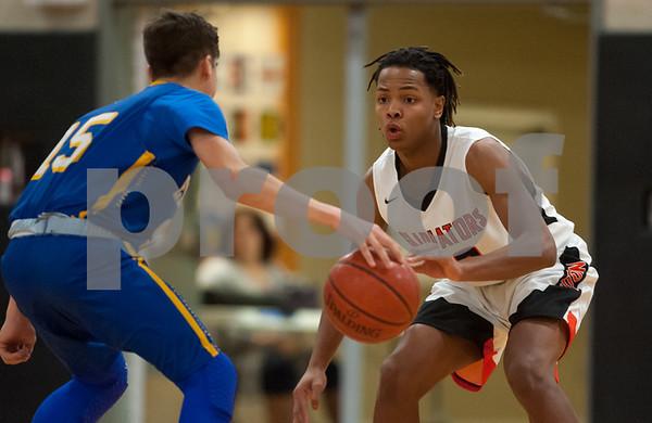01/26/18 Wesley Bunnell | Staff E.C. Goodwin boys basketball vs Ellis Tech on Friday evening at E.C. Goodwin High School. Nefaru Murray with a steal.