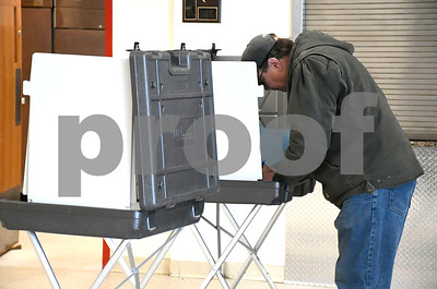 1/30/2018 Mike Orazzi | Staff Plainville resident Bob Swiatek votes on upgrades to the town's water pollution control facility Tuesday afternoon.