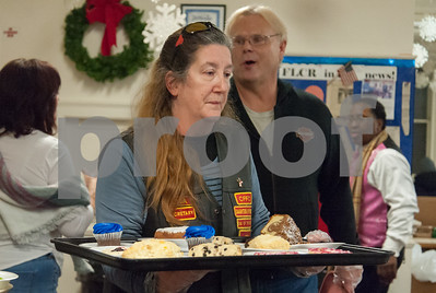 01/31/18  Wesley Bunnell | Staff  The Sons of Abraham Motorcycle Association gather every Wednesday at the First Lutheran Church in New Britain to help serve meals to the homeless.  Association member Lisa LaPierre carries a tray of dessert out from the kitchen.