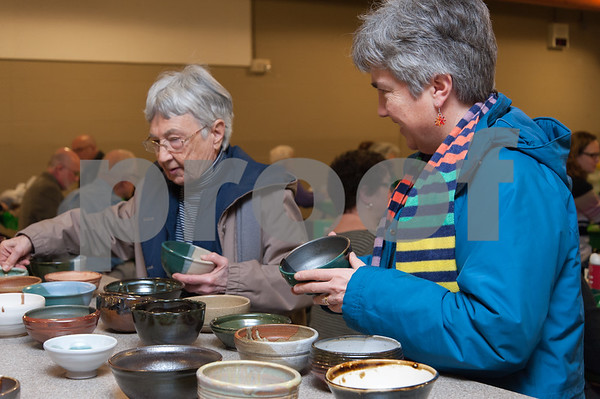 01/31/18 Wesley Bunnell | Staff The Friendship Service Center held their first ever Souper Bowl at E.C. Goodwin on Wednesday evening to raise awareness of hunger and provide funding their soup kitchen. Guests were able to buy a handcrafted ceramic bowl made by Central Connecticut State University art students as the entrance fee and have it filled with the soup of their choice. Students from E.C. Goodwins culinary department handled the serving of the soups. Antoinette Price and daughter Ruth Satterberg look over the bowls available.