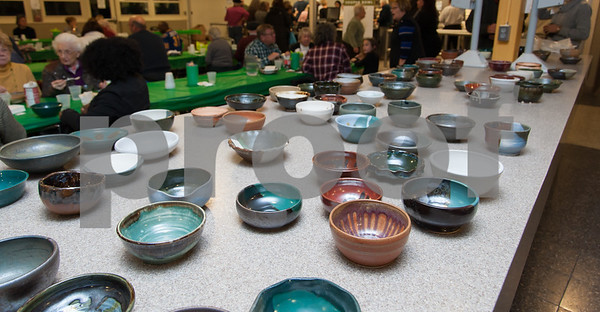 01/31/18 Wesley Bunnell | Staff The Friendship Service Center held their first ever Souper Bowl at E.C. Goodwin on Wednesday evening to raise awareness of hunger and provide funding their soup kitchen. Guests were able to buy a handcrafted ceramic bowl made by Central Connecticut State University art students as the entrance fee and have it filled with the soup of their choice. Students from E.C. Goodwins culinary department handled the serving of the soups. Approximately 400 bowls were available for guests to purchase.