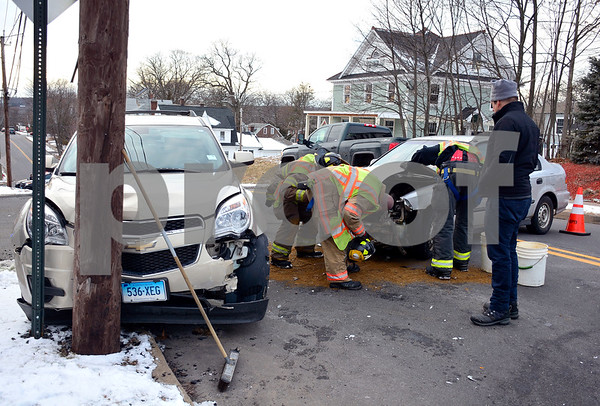 1/31/2018 Mike Orazzi | Staff The scene of a two-car crash on Woodland Street in Bristol Wednesday afternoon. Both cars were towed from the scene and no injuries were reported.