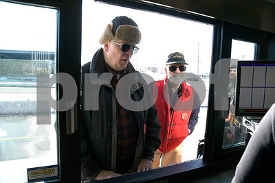 1/10/2018 Mike Orazzi | Staff Bill Manka and Bill Grossberndt stand in line at the drive through window at Chick-fil-A while in parking outside the new location in Southington the day before opens Wednesday.