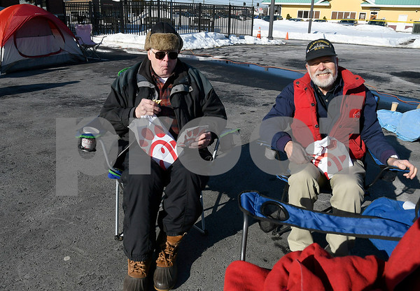 1/10/2018 Mike Orazzi | Staff Bill Manka and Bill Grossberndt eat Chick-fil-A while in parking outside the new location in Southington the day before opens Wednesday.