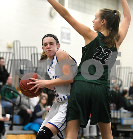 1/11/2018 Mike Orazzi | Staff Bristol Eastern's Paige McLaughlin (2) and Enfield's Kaitlyn Bourque (22) during Thursday night's girls basketball game at BE.