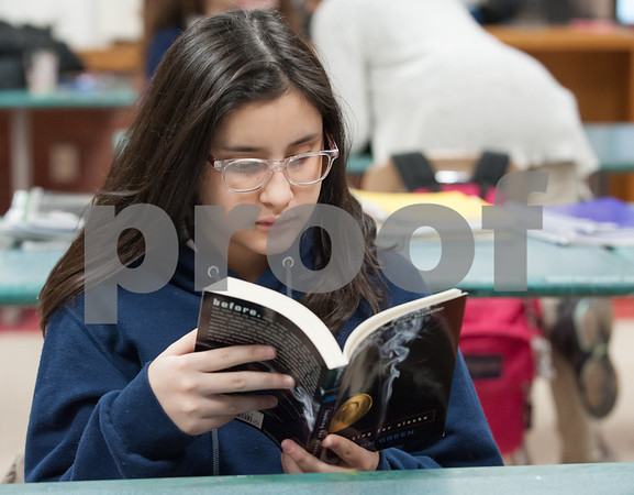 01/11/18 Wesley Bunnell | Staff 45 students from Slade Middle School participate in an American Savings Foundation funded program through the YWCA for youth development opportunities. Activities involve homework, social programs and team building activities. Juliana Ospina reads a book during class.