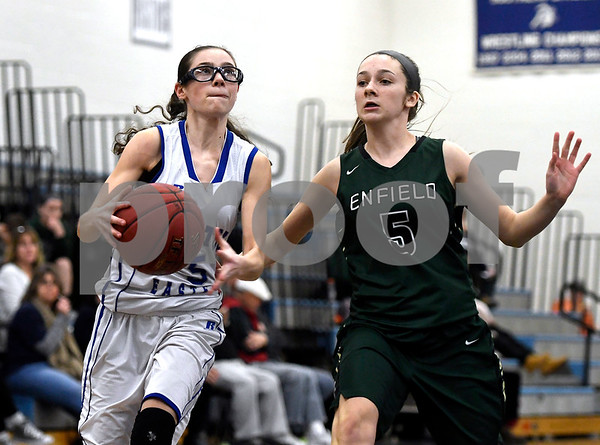 1/11/2018 Mike Orazzi | Staff Bristol Eastern's Miranda Janick (5) and Enfield's Shelby Bedard (5) during Thursday night's girls basketball game at BE.