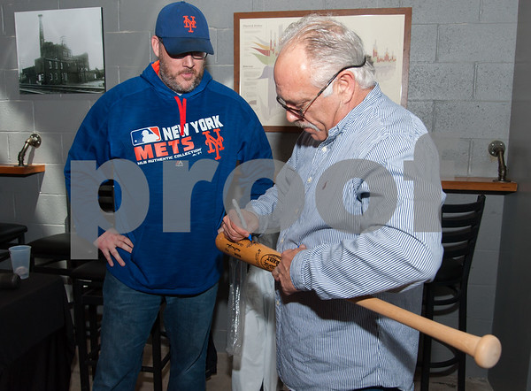 01/12/18 Wesley Bunnell | Staff New Bees Manager Wally Backman met fans and signed autographs at Alvarium Beer Company in New Britain on Friday night. Mike Doran has a bat autographed by Backman.