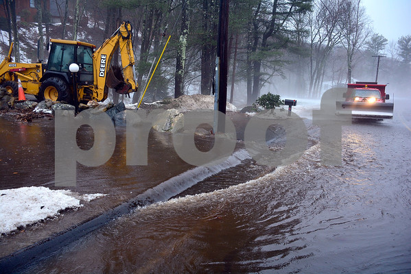 1/12/2018 Mike Orazzi | Staff Plymouth public works opens a drain causing a flooding issue on Old Waterbury Road during Friday's rain storm.