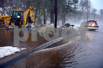 1/12/2018 Mike Orazzi   Staff Plymouth public works opens a drain causing a flooding issue on Old Waterbury Road during Friday's rain storm.