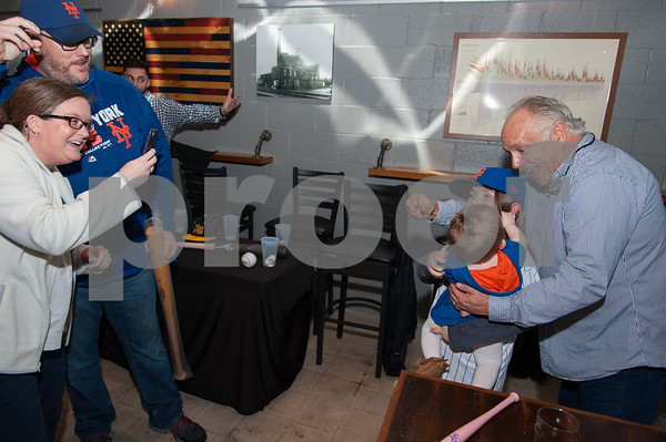 01/12/18 Wesley Bunnell | Staff New Bees Manager Wally Backman met fans and signed autographs at Alvarium Beer Company in New Britain on Friday night. Sara and Mike Doran take a photo as their children Madi, age 9, and Shea, age 7 months, pose for a photo with Backman.