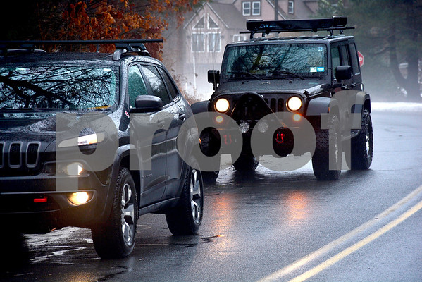 1/12/2018 Mike Orazzi | Staff My favorite color Jeeps out during Friday's rain storm in Plymouth.