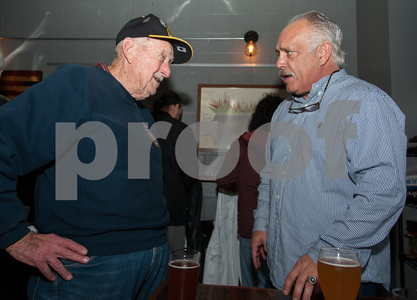 01/12/18 Wesley Bunnell | Staff New Bees Manager Wally Backman met fans and signed autographs at Alvarium Beer Company in New Britain on Friday night. Al Nelson, L, who has held season tickets for professional New Britain baseball since baseball moved to the city has a chance to talk baseball with Backman.