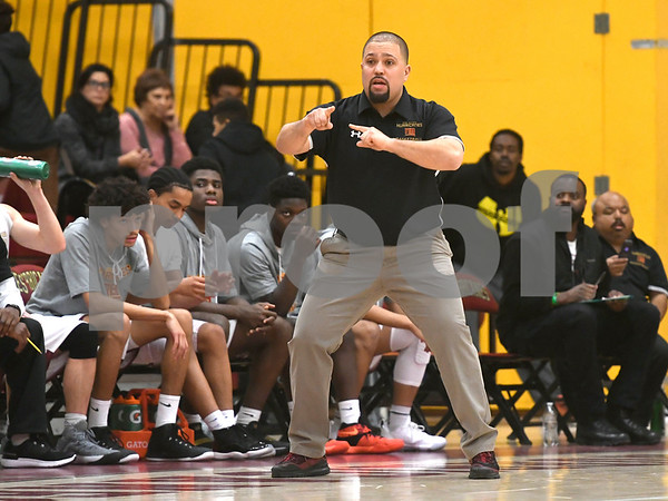 1/13/2018 Mike Orazzi | Staff New Britain Head Coach Kurt Reis against Medgar Evers College Preparatory School at New Britain High School Saturday.