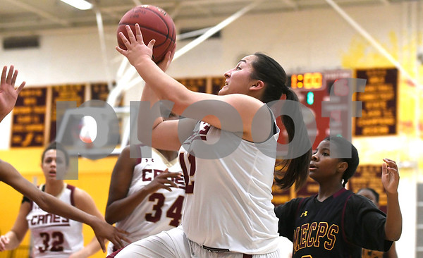 1/13/2018 Mike Orazzi | Staff New Britain's Gabby Roy (42) during Saturday's girls basketball game with Medgar Evers College Preparatory School in New Britain.