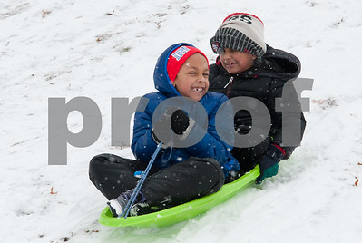 01/17/18  Wesley Bunnell | Staff  Six year old twins, Jayden and Alysse Jackson head down a hill in Walnut Hill Park on Wednesday after a snowstorm spread several inches of snow starting earlier Wednesday morning.