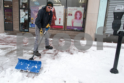 01/17/18  Wesley Bunnell | Staff  A worker from Northeast Snow Removal shovels the sidewalk near Central Park on Wednesday morning after a new storm spread several inches of snow.