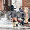 01/17/18  Wesley Bunnell   Staff<br /> <br /> The New Britain Fire Department battled a structure fire at 42 Connerton St. starting late on Tuesday night and continued into Wednesday morning. The building sustained severe damage with with interior structural collapse and a total roof collapse. One firefighter  was injured and transported to the hospital for observation and released. New Britain Firefighters carry a second pump to assist in pumping out the several inches of water which accumulated in the basement from firefighting efforts.