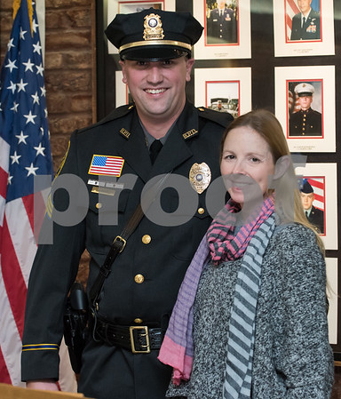 01/17/18 Wesley Bunnell | Staff The Berlin Police Department held a promotion ceremony for two officers on Wednesday evening at town hall. Allison Gould stands with her husband Sergeant Ryan after helping to pin on his new badge.