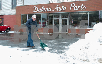 01/17/18  Wesley Bunnell | Staff  Dan Dalena shovels the parking lot in front of the auto parts store he owns with his brother on Wednesday morning after a storm spread several inches of snow across the area.