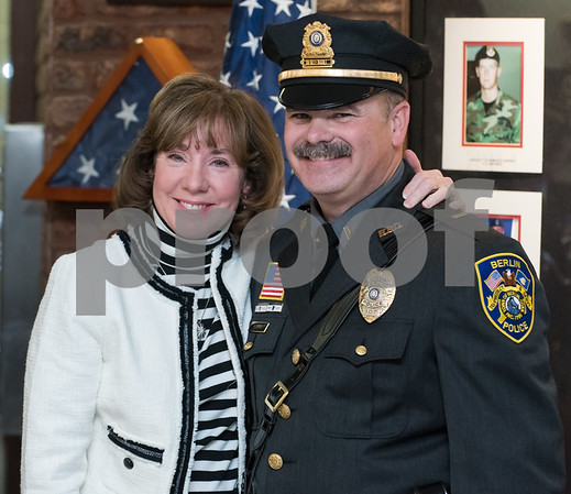 01/17/18 Wesley Bunnell | Staff The Berlin Police Department held a promotion ceremony for two officers on Wednesday evening at town hall. Eileen Gallupe smiles with her husband Lieutenant Drew Gallupe after pinning on his new badge.