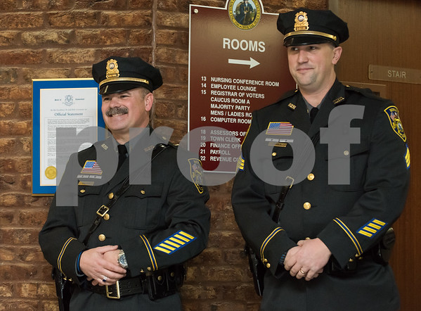 01/17/18 Wesley Bunnell | Staff The Berlin Police Department held a promotion ceremony for two officers on Wednesday evening at town hall. New promoted Lieutenant Drew Gallupe and Sergeant Ryan Gould.