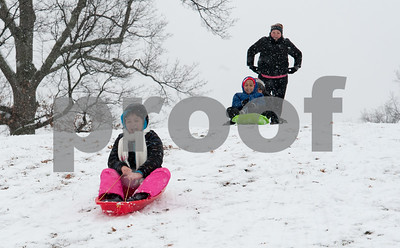 01/17/18  Wesley Bunnell | Staff  Christiana Calkins heads down a hill in Walnut Hill Park on Wednesday after snowfall through the day left a new blanket of snow while friends Jayden and Alysse Jackson wait with their mom for their turn.
