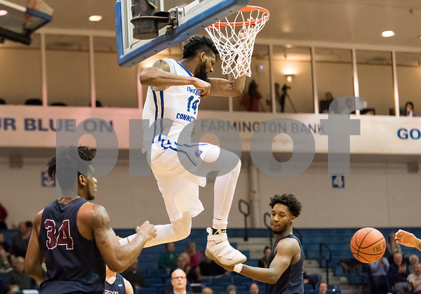 01/18/18 Wesley Bunnell | Staff CCSU Men's basketball defeated Fairleigh Dickinson University 66-65 at CCSU. Deion Bute (14) with a dunk on the first half.