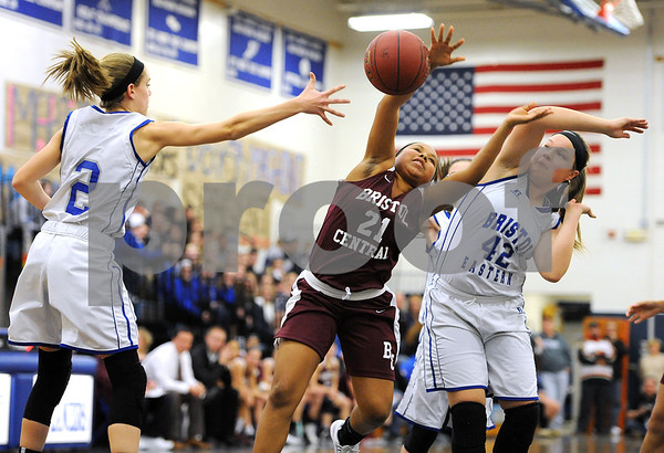 1/18/2018 Mike Orazzi | Staff Bristol Central's Ideara Gordon (21) and Bristol Eastern's Paige McLaughlin (2) and Avery Arbuckle (42) during the girls basketball game at BEHS Thursday night.