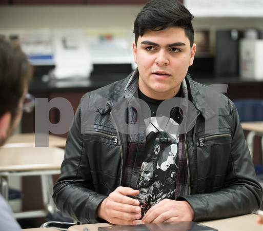 01/18/18 Wesley Bunnell | Staff 10th grade student at New Britain High School Angel Diaz in class on Thursday afternoon. Angel is part of a group of students who have relocated to New Britain from Puerto Rico following the devastating Hurricane Maria.