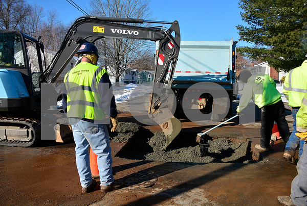 1/18/2018 Mike Orazzi | Staff A water main is repaired on Madison Drive in Bristol Thursday.