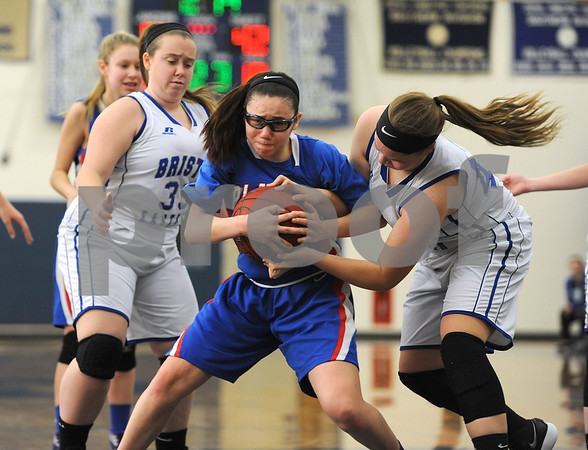 1/20/2018 Mike Orazzi | Staff Plainville's Jaida Vasquez (5) and Bristol Eastern's Avery Arbuckle (42) during Saturday's girls basketball game.