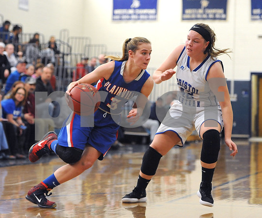 1/20/2018 Mike Orazzi | Staff Plainville's Caitlin Barker (3) and Bristol Eastern's Avery Arbuckle (42) during Saturday's girls basketball game with Bristol Eastern in Bristol.