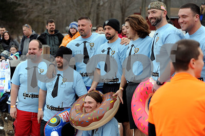 1/20/2018 Mike Orazzi | Staff The 13th Annual Sloper Plunge at Camp Sloper in Southington Saturday.