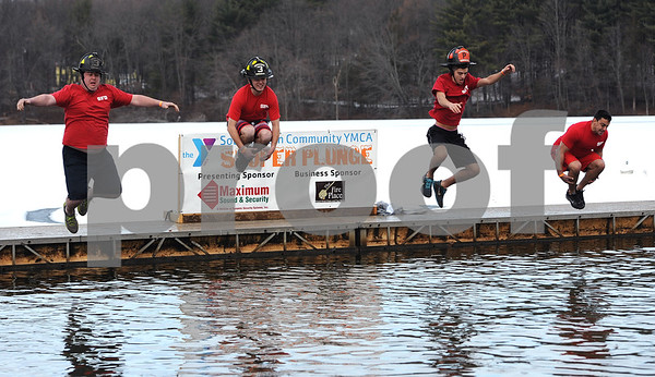 1/20/2018 Mike Orazzi | Staff Southington Volunteer firefighters during the 13th Annual Sloper Plunge at Camp Sloper in Southington Saturday.
