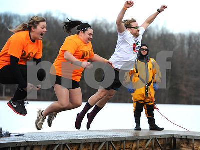 1/20/2018 Mike Orazzi | Staff Rob Lalla (far right) during the 13th Annual Sloper Plunge at Camp Sloper in Southington Saturday.